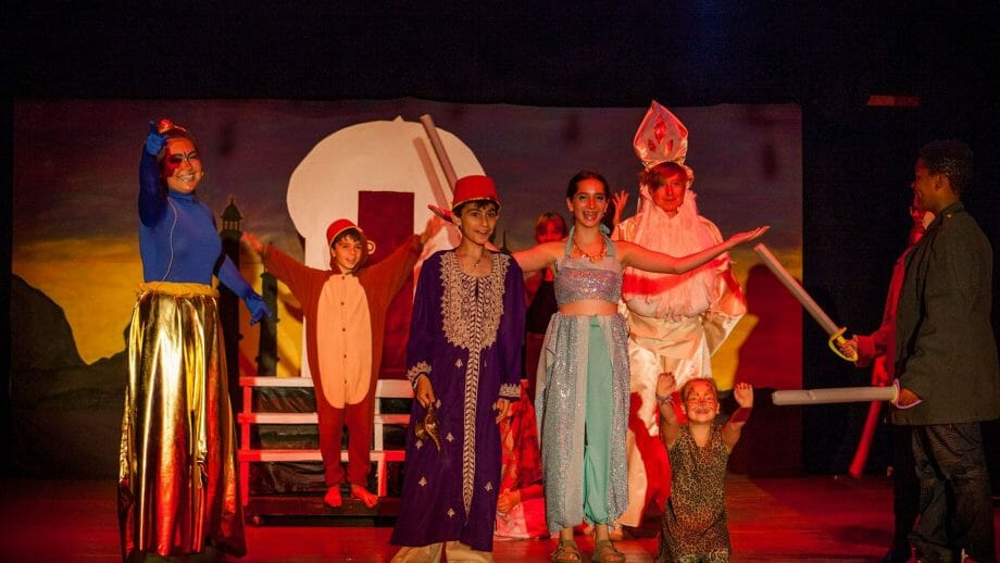 Campers performing Aladdin play