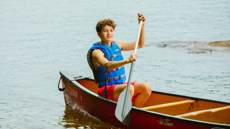 Boy canoeing on the lake