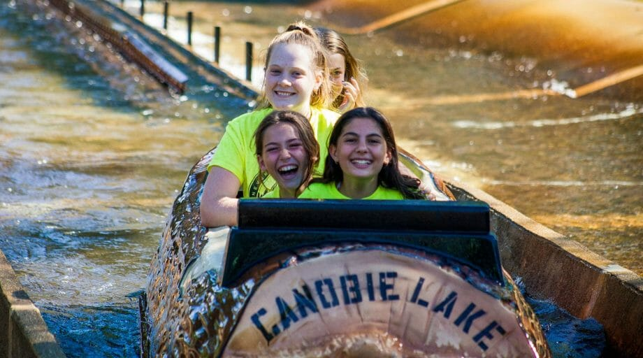 Campers on the log ride at Canobie Lake Park on an off-camp trip