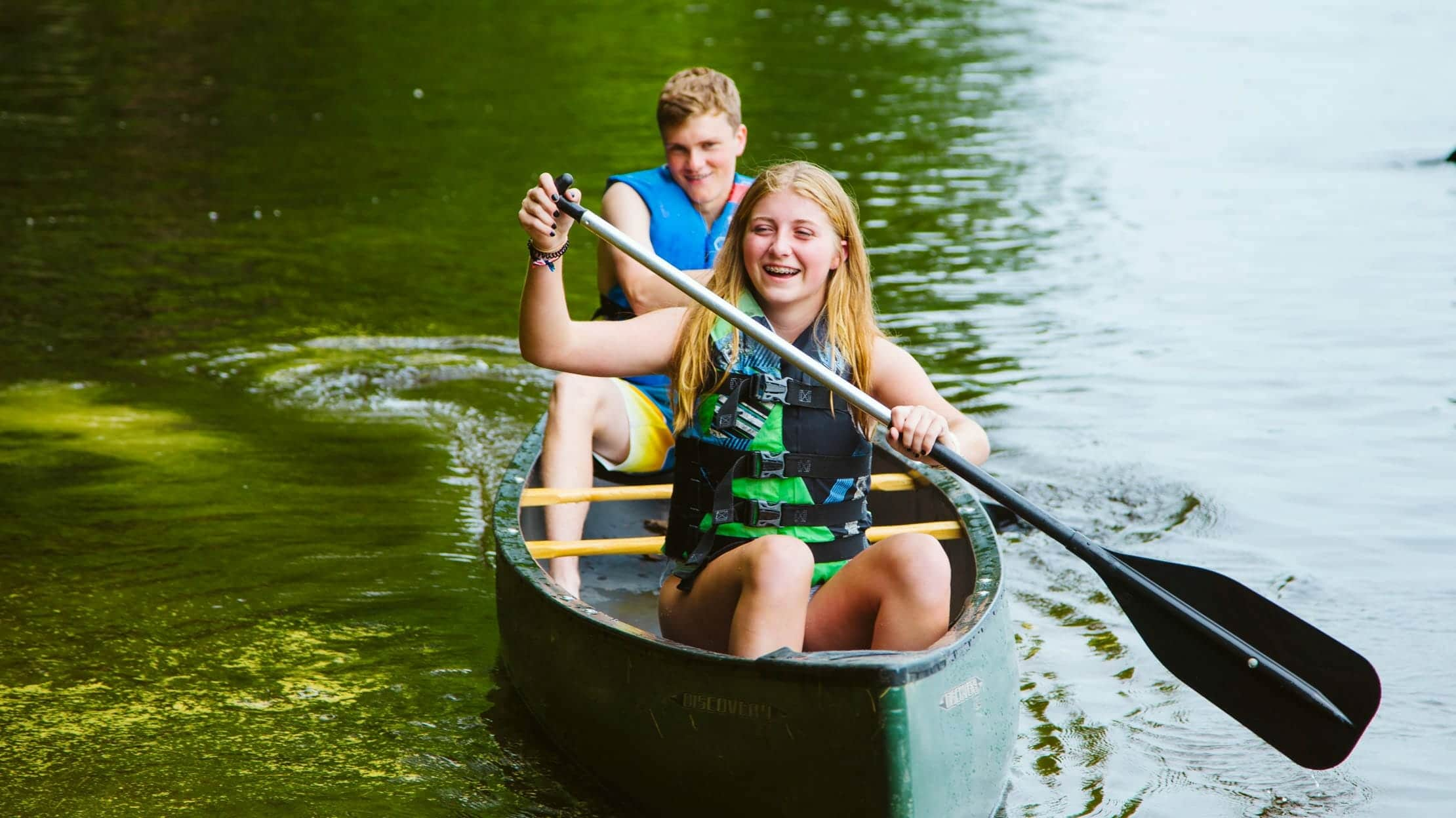 Two campers canoeing on a lake