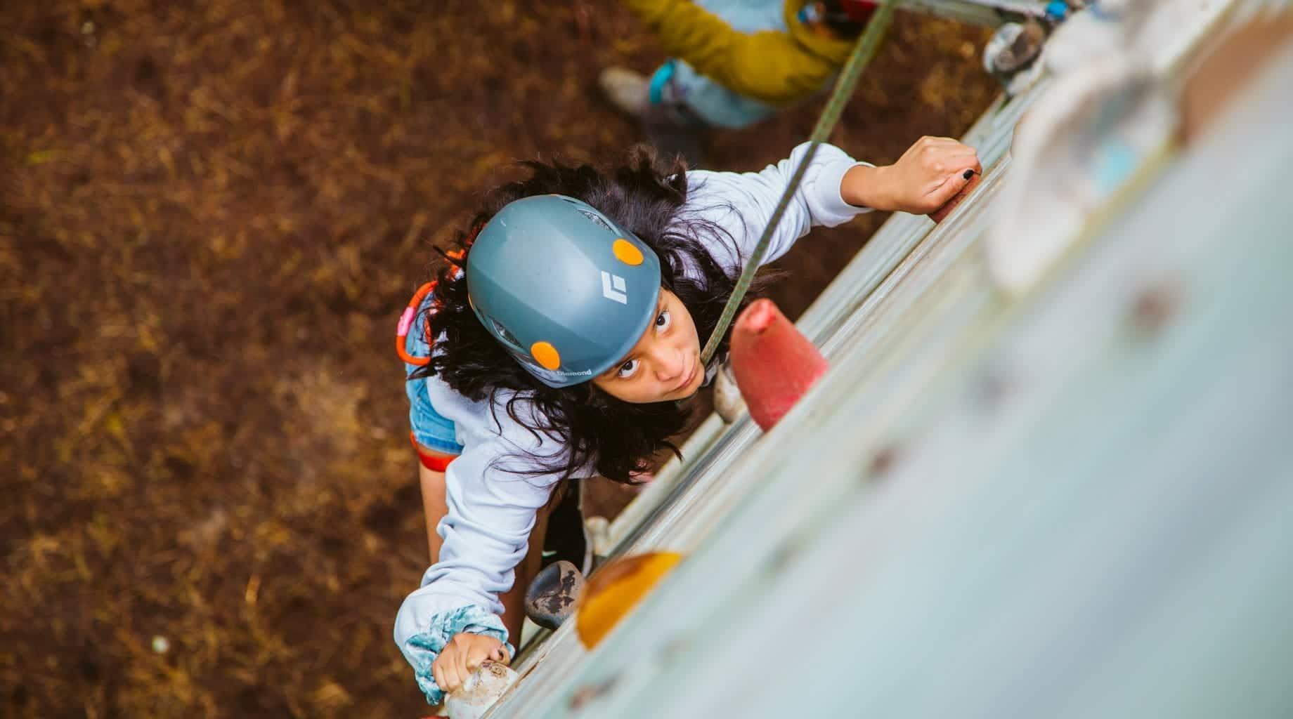 Girl on climbing tower