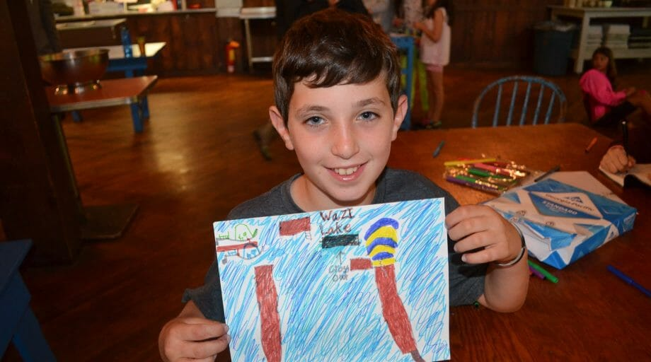 Boy showing his drawing