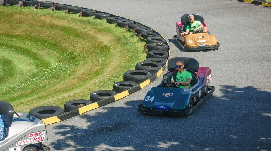 Campers go-karting at an off camp trip