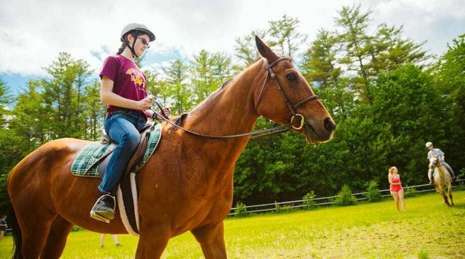 Camper horseback riding