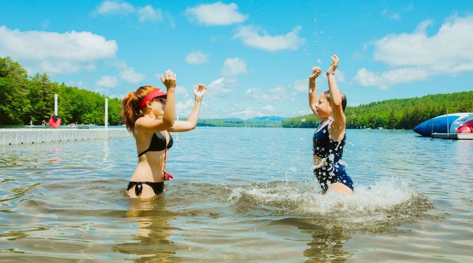 Staff teaching camper how to swim