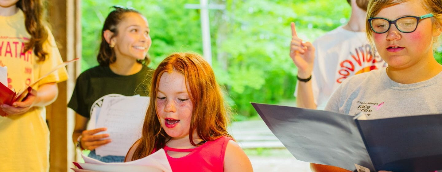 Girls singing for a performance