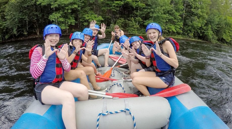 Campers rafting on an off-camp trip