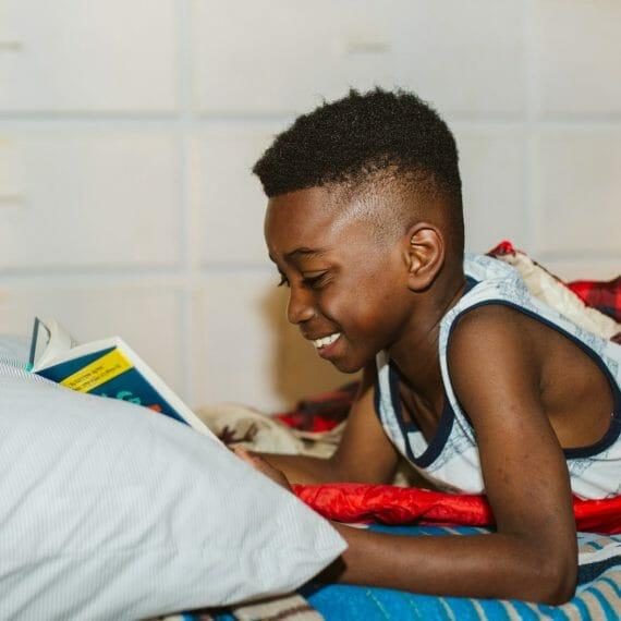 Boy reading in cabin