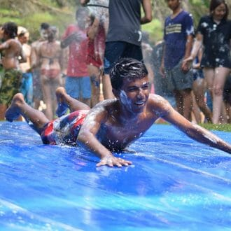 Camper covered in shaving cream on the slip n slide