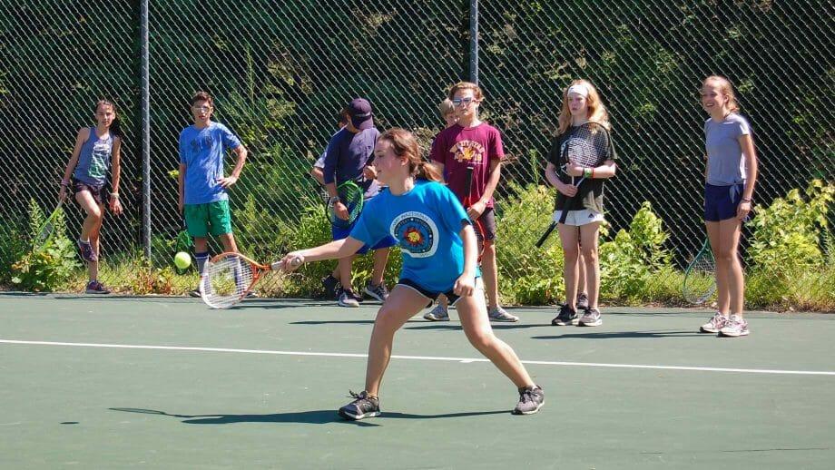 Camper hitting a tennis ball