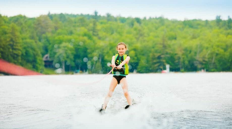 Young girl waterskiing on the lake