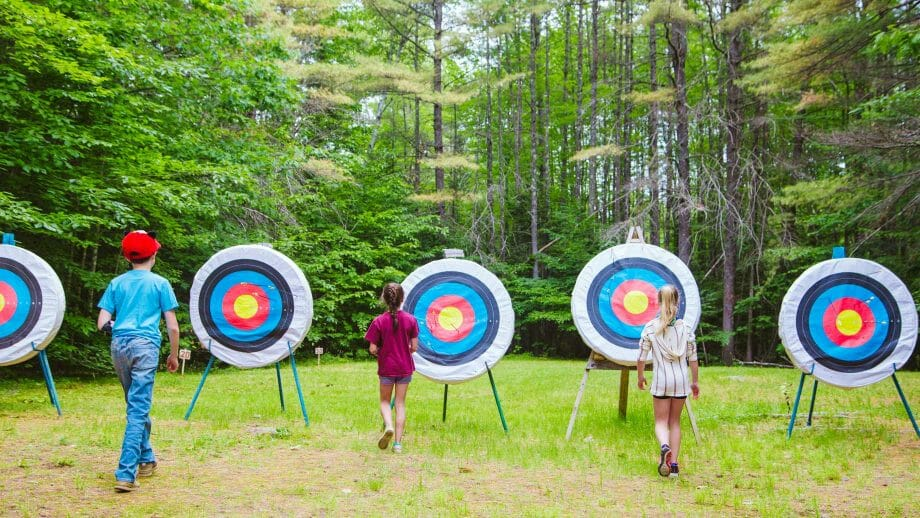 Three campers by archery targets