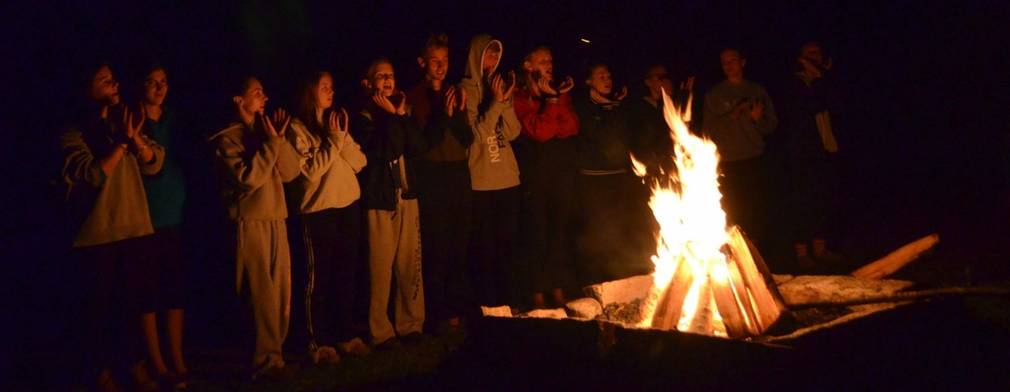 Singing around a campfire