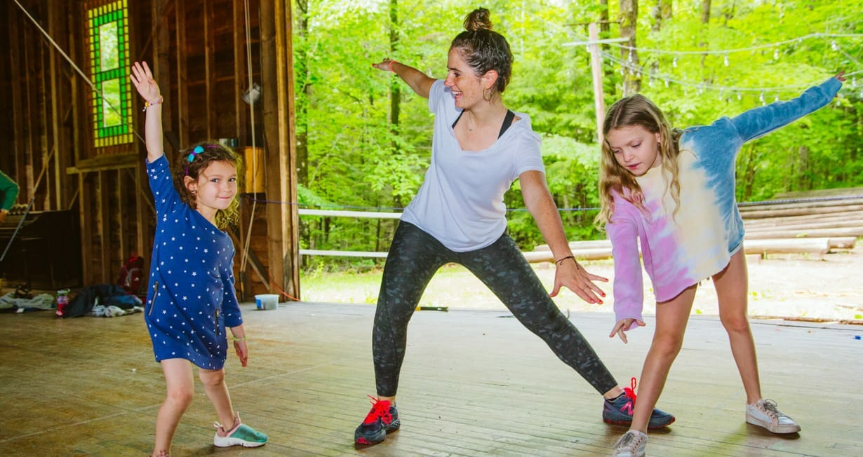 Dance instructor teaching campers dance moves