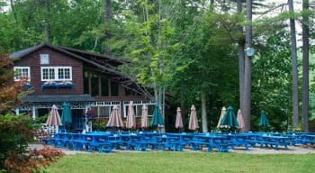 Dining hall and picnic tables set up outside