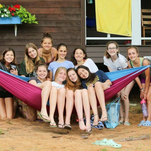 Girls on a hammock by their cabin