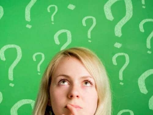 Mom's head on a green background with questions marks floating above
