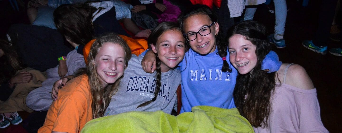 Four girls in sleeping bags at a special events sleepover
