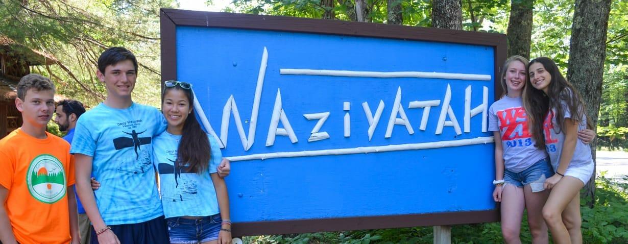 Campers standing near Waziyatah sign