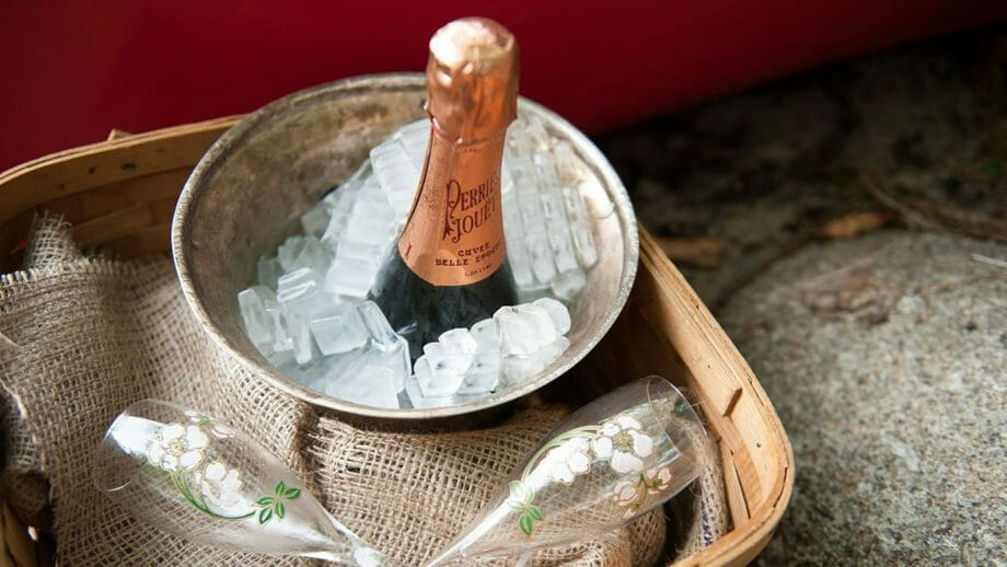 Champagne in a bucket with ice at a wedding