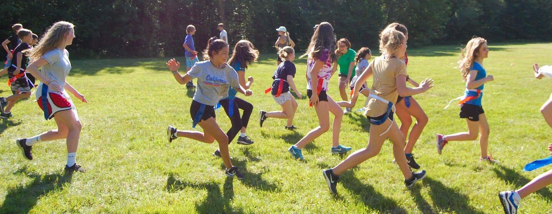 Girls running during flag football game